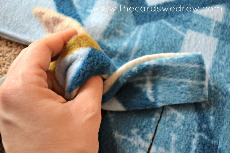 tying the knot on the blanket