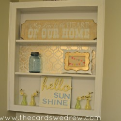 bathroom shelf makeover with gold paint and stenciling