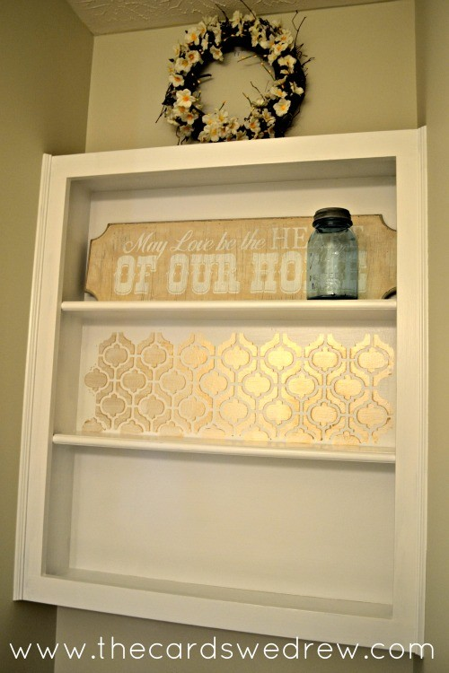 gold stenciled bathroom shelf
