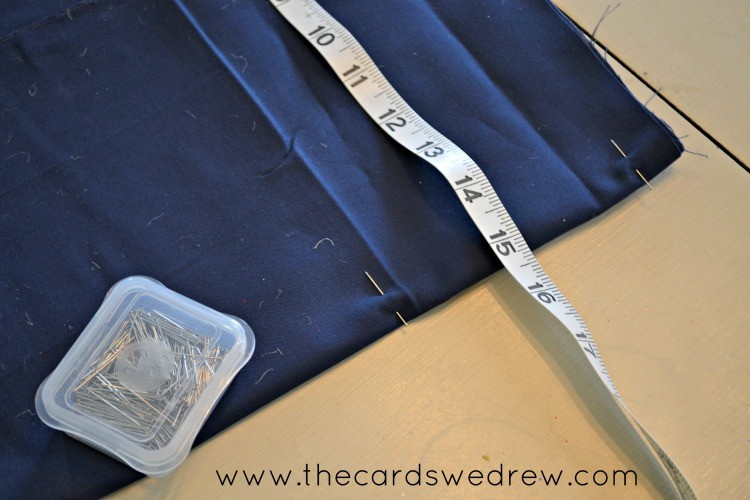 Measure your fabric and pin it