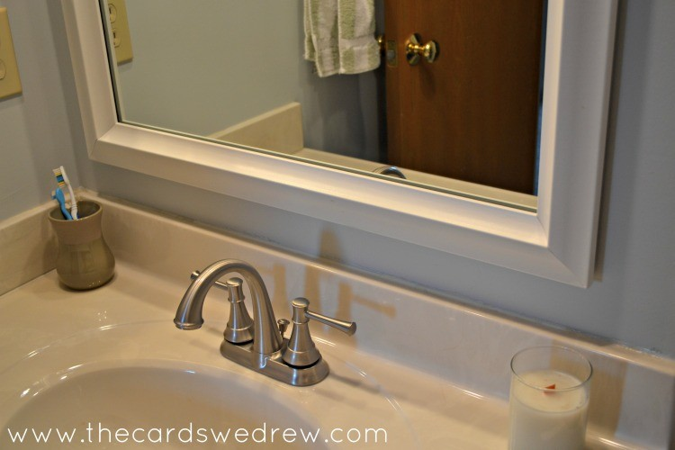 new sink fixtures and mirror frame