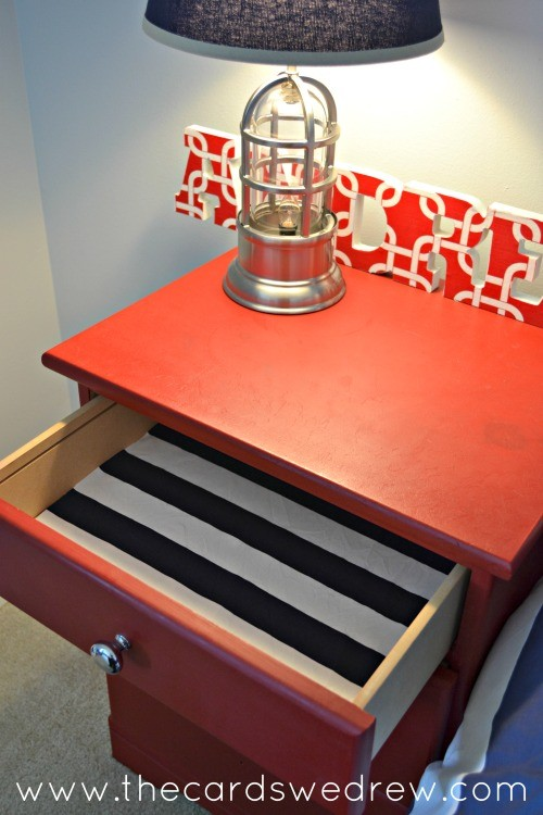red dresser with blue and white fabric liner
