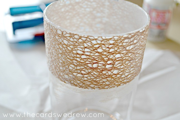 Apply ribbon to vase with mod podge layer by layer
