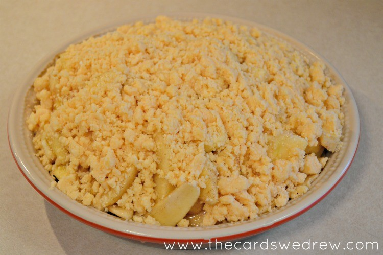 top the pie and apples with the cake mix and butter mixture