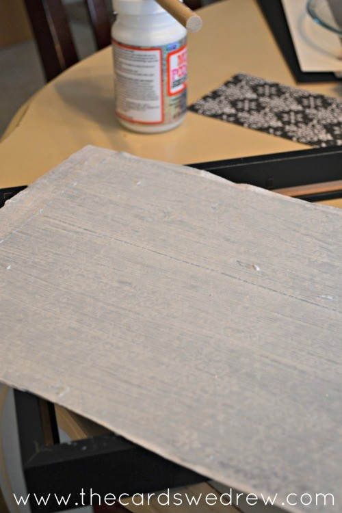 apply paper with mod podge to glass