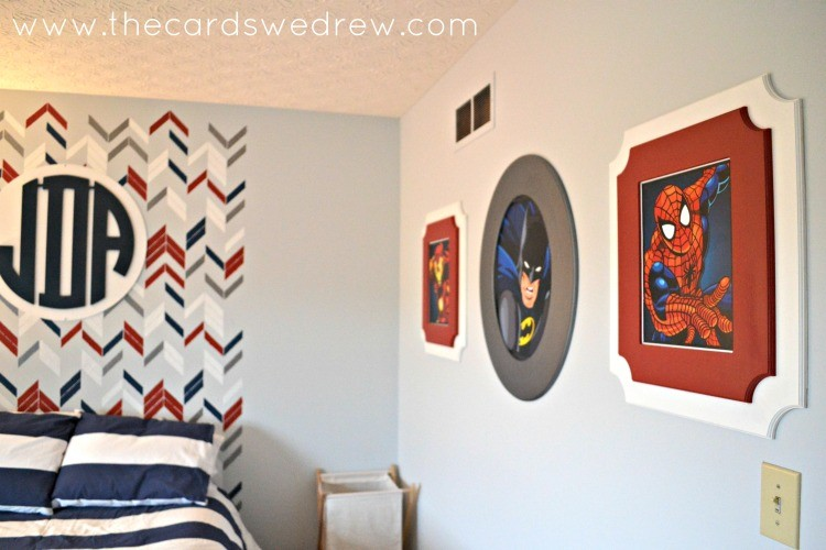 boys superhero bedroom with frames