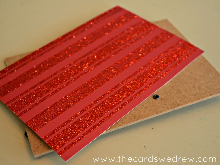 cut a piece of scrapbook paper to fit your frame