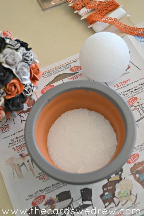 add styrofoam to the bottom of the pot