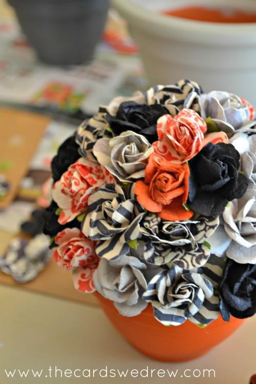 glue flowers onto styrofoam ball