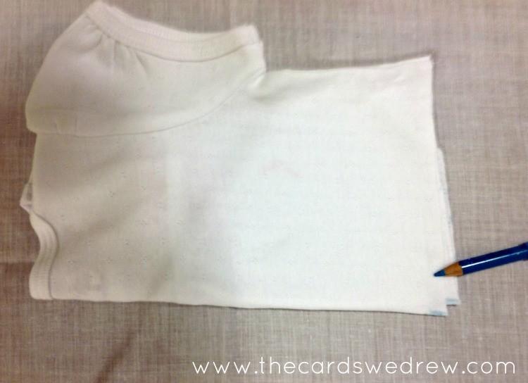 fold the onesie in half