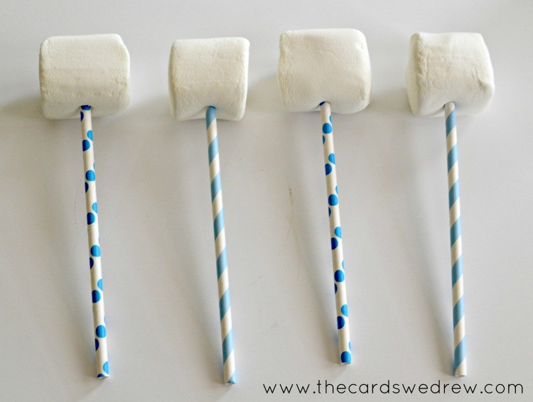 place jumbo marshmallows on a stick