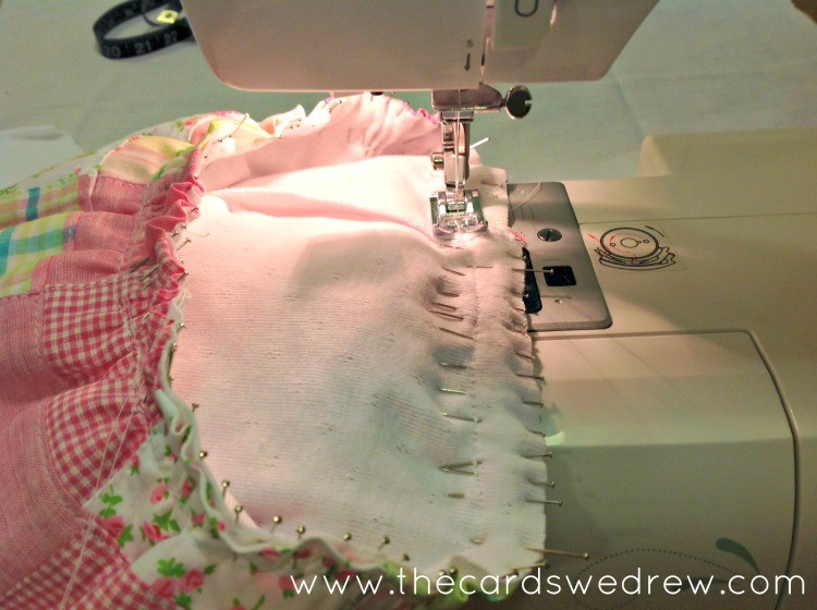 sewing the skirt to the onesie