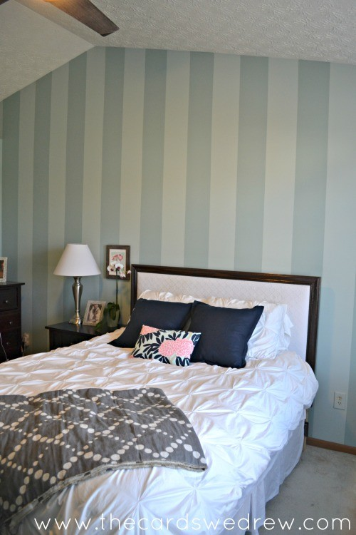 striped accent wall in master bedroom