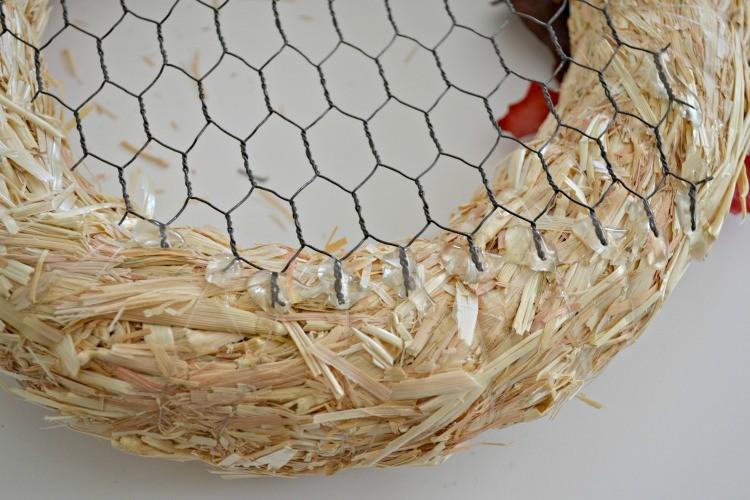 gluing chicken wire onto wreath form