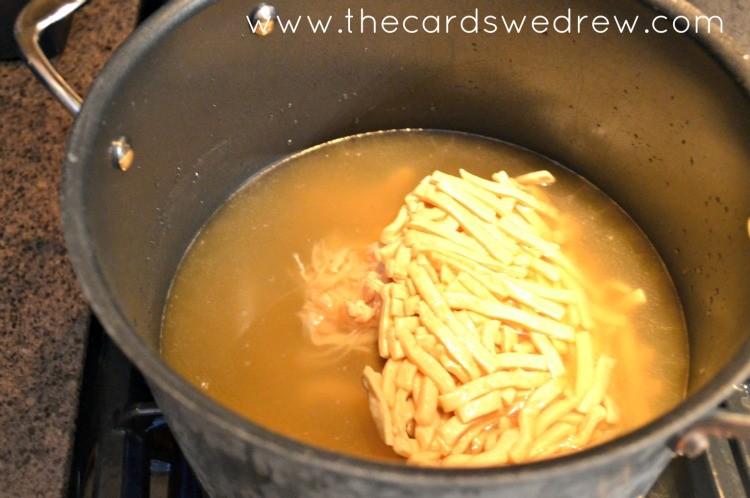 chicken noodles in a pot