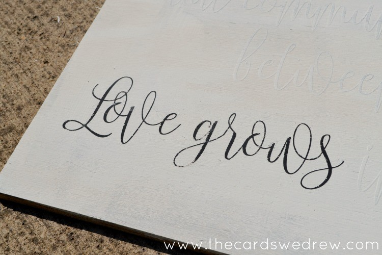 love grows in little houses vinyl sign