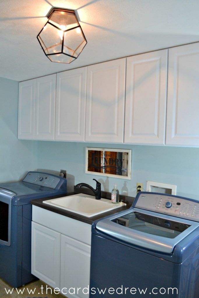 white cabinet laundry room makeover