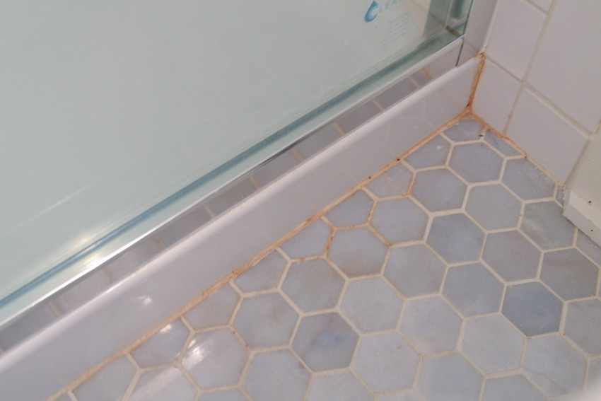 orange stains in grout