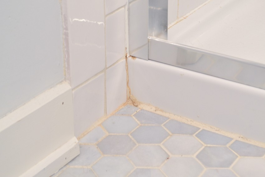 what are the orange stains in my bathroom grout